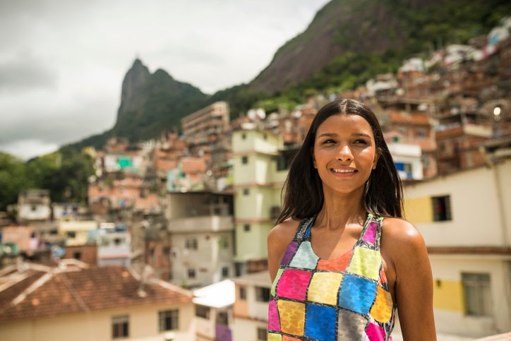 A woman in Brazil smiles while looking off camera