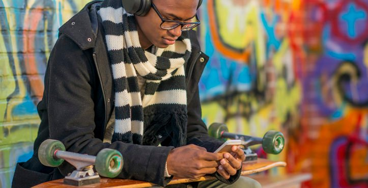 A young man shopping online on a mobile device