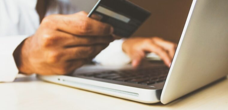 A person using a credit card to pay online.