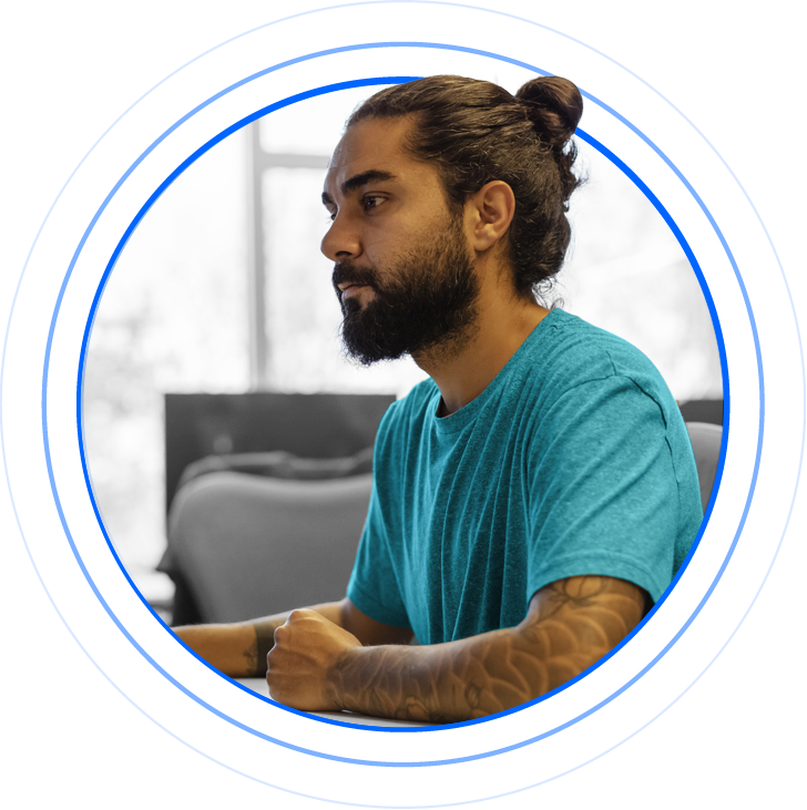 A developer with beard and ponytail developing an online payment checkout solution.