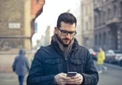 Man holds cellphone in a European city