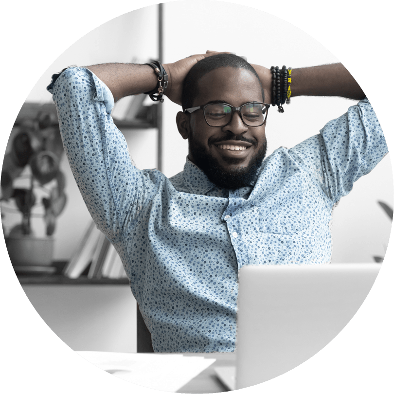 A man puts his hands behind his head and relaxes after simplifying secure online payment processing.